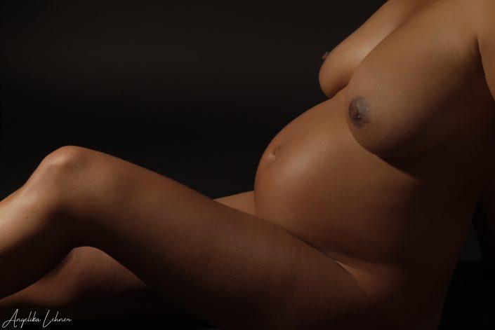 Foto einer Schwangeren mit Babybauch Fotografie
